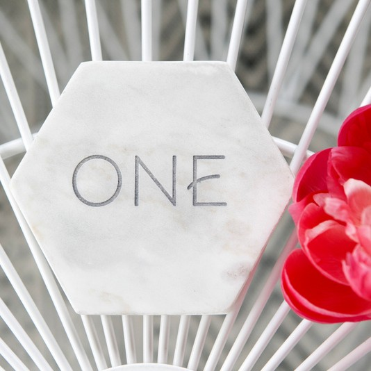 Laser etched and filled marble table numbers
